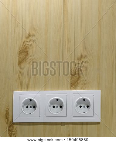 three dirty electrical outlets in the office