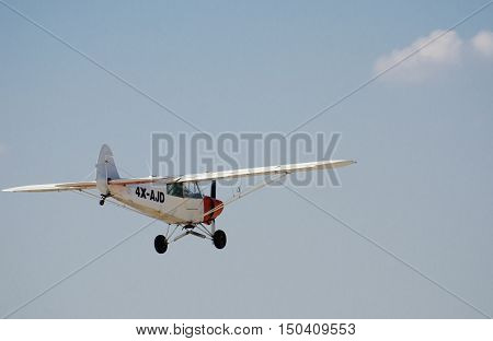 Aircraft Piper Pa-18-150 Super Cub On Fly On The Backgroynd Of The Sky