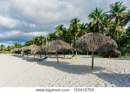 The most beautiful species in the Atlantic Ocean and beach with umbrellas in the resort of Varadero, Cuba