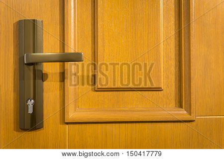 Closeup of wooden door with metal handle