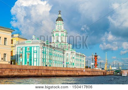 ST PETERSBURG RUSSIA - OCTOBER 3 2016. Architecture landscape of St Petersburg Russia - Kunstkamera rostral column and Peter and Paul fortress along the Neva river in St Petersburg Russia