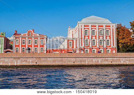 ST PETERSBURG RUSSIA - OCTOBER 32016. Architecture landmarks of St Petersburg - Twelve Colleges building and Rector of the University's outbuilding in St Petersburg in sunny day