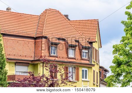 Fragment of a very neat and colorful home with gorgeous outdoor landscape in suburbs