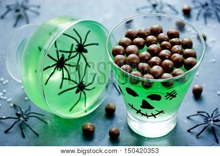 Creative idea for Halloween dessert drink food serving - green monster jelly for kids party