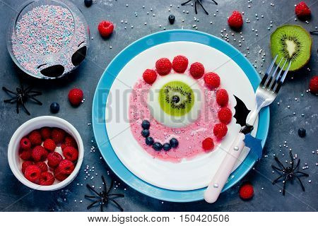 Halloween dessert recipe idea scary fun and tasty one-eyed monster jelly panna cotta with fruit and berry
