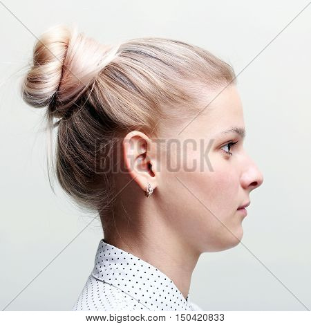 Blonde woman profile face. Girl profile. Hairstyle
