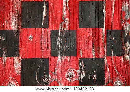 Close up of an old wooden checker board red and black
