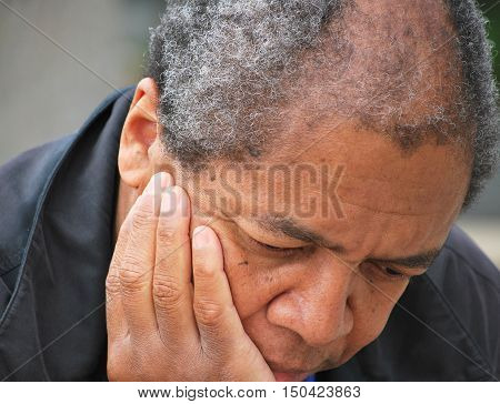 African american male senior expressions outside alone