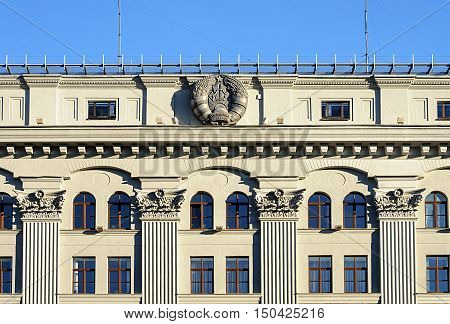 Minsk, Belarus - September 13, 2016: Top of National bank of Belarus Republic with coat of arms of Belarus