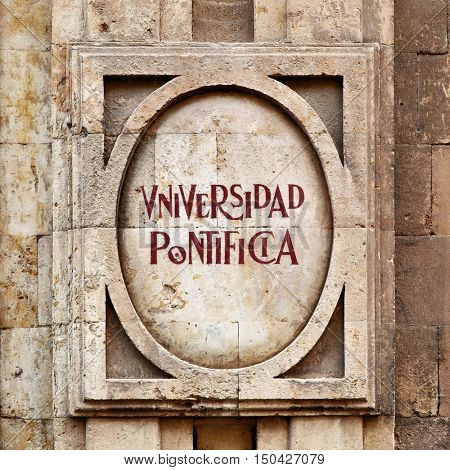 SALAMANCA, SPAIN - September 03, 2016: Signboard of Pontifical University in Salamanca