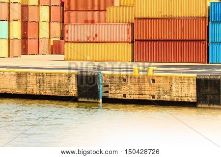 Various containers waiting in port. Cargo goods in harbour. Commerce transport maritime shipping concept.