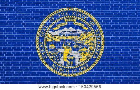 Nebraskan official flag symbol. American patriotic element. USA banner. United States of America background. Flag of the US state of Nebraska on brick wall texture background, 3d illustration