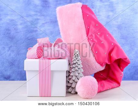 Female Santa Hat With Pink And White Gift.