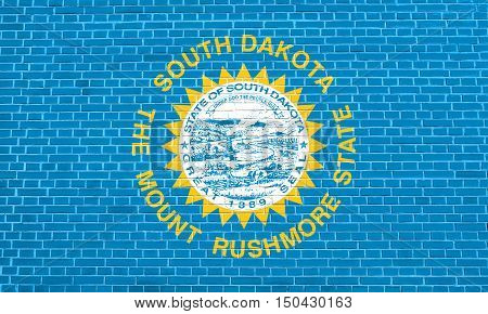 South Dakotan official flag symbol. American patriotic element. USA banner. United States of America background. Flag of the US state of South Dakota on brick wall texture background, 3d illustration