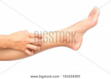 Woman hand scratching on feet with white backgroud for healthy concept