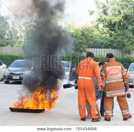 BANGKOK, THAILAND- JULY 31: Fire training by a firefighter on July 31, 2016 in Bangkok, Thailand.