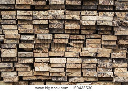 Pile of stacked rough cut lumber, close up