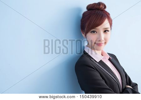 business woman is smile to you and cross arm with blue background asian