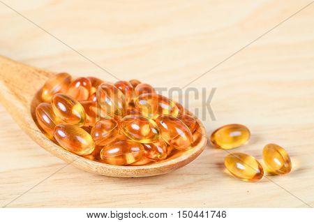Cod liver oil omega 3 gel capsules on white background.