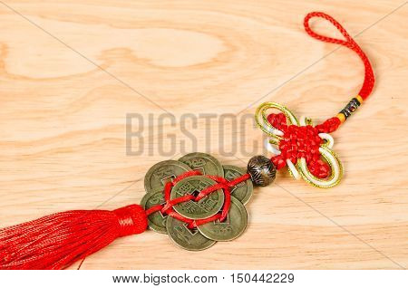 The Chinese Ancient Coins on wooden background.