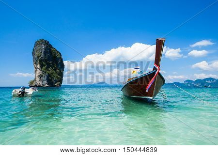 Long tail boat on crystal clear water at Poda Island, Krabi Thailand