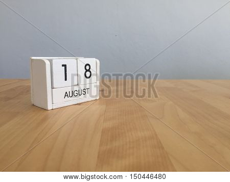 August 18th.August 18 white wooden calendar on wood background.Summer day.Copyspace for your text.