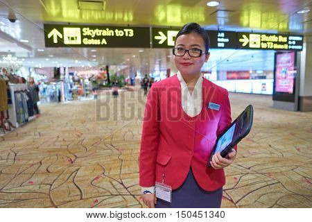 SINGAPORE - CIRCA AUGUST, 2016: indoor portrait of a airport staff in Singapore Changi Airport. Changi Airport, is the primary civilian airport for Singapore.