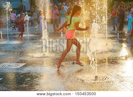 Beautiful Girl In A Fountain