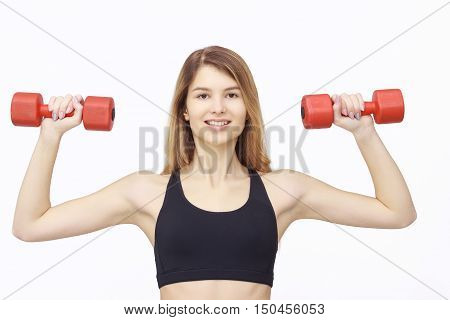 Shot of a sporty young woman with dumbbells. Active sporty life, wellness