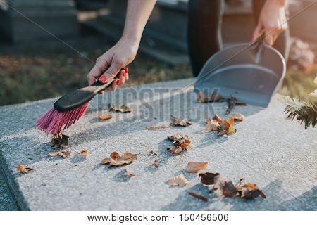A Woman Cleans The Grave