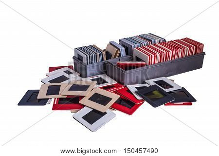 35 mm mounted film slides into the plastic and cardboard different colored frames and plastic boxes isolated on white background cliping path embedded