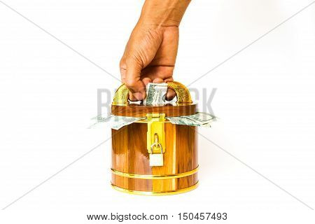 Hand Holding Key To Open Wooden Money Box With Dollar