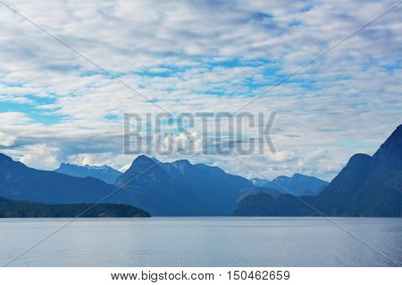 Beautiful seascape along Pacific coast of British Columbia, Canada, with rocky shoreline.