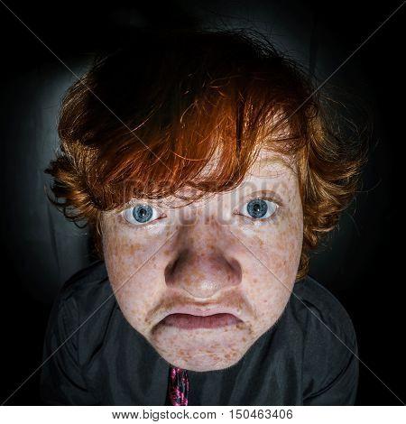 Emotive Portrait Of Red-haired Freckled Boy, Childhood Concept