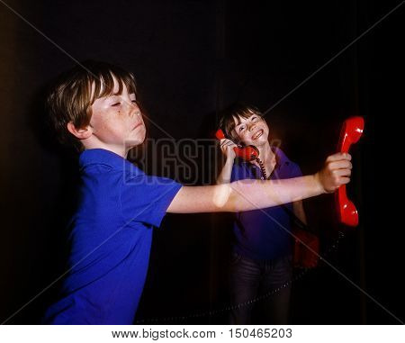 Freckled Boy Speaking Old-style Red Phone, Double-exposition