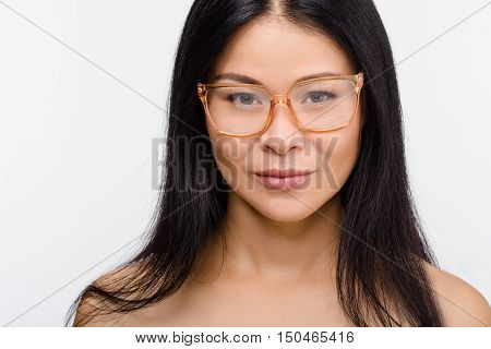Closeup picture of beautiful Korean or Asian woman in glasses isolated on white background in studio. Beauty, vision concepts.