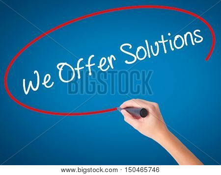 Women Hand Writing We Offer Solutions With Black Marker On Visual Screen