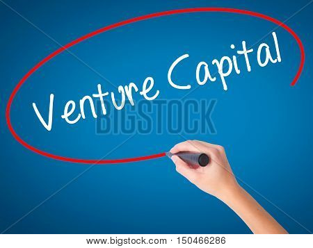Women Hand Writing Venture Capital With Black Marker On Visual Screen