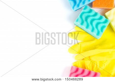Close up of rubber gloves and sponges over white background. Tpview