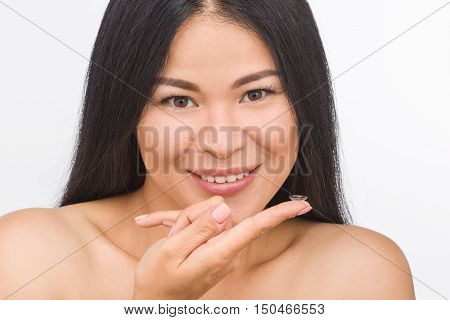 Portrait of happy smiling woman with contact lenses isolated on white. Attractive lady looking at camera in studio.