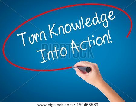 Women Hand Writing Turn Knowledge Into Action! With Black Marker On Visual Screen