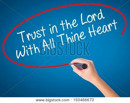 Women Hand Writing Trust In The Lord With All Thine Heart With Black Marker On Visual Screen