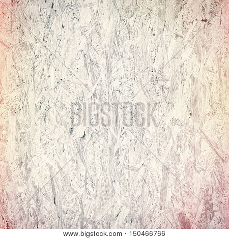 Light colorful recycled hardboard. Chipboard wall. Wooden texture