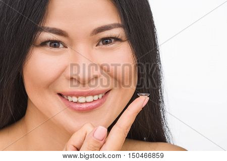 Closeup picture of pretty Korean or Asian woman with contact lenses isolated on white backgroind in studio.