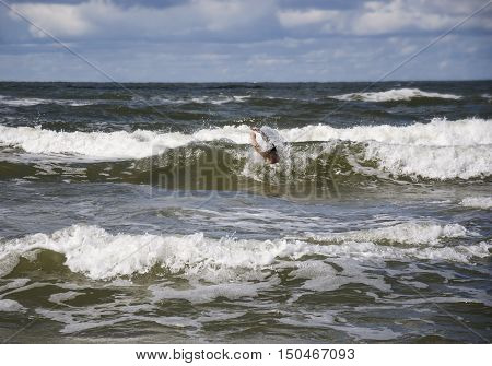 Drowning man in sea asking for help with raised his arms. Safety