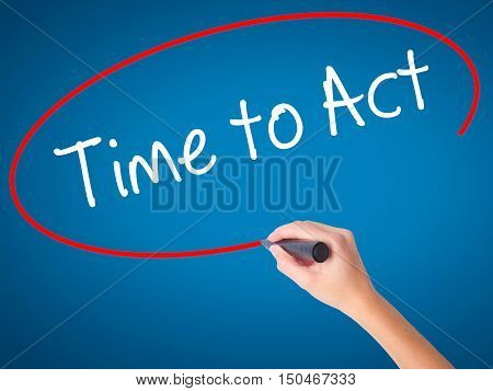 Women Hand Writing Time To Act With Black Marker On Visual Screen.