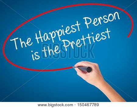 Women Hand Writing The Happiest Person Is The Prettiest With Black Marker On Visual Screen.