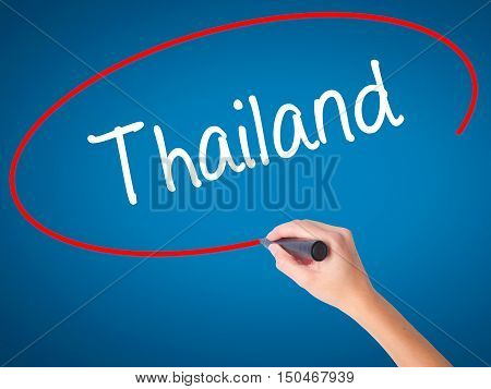 Women Hand Writing Thailand  With Black Marker On Visual Screen
