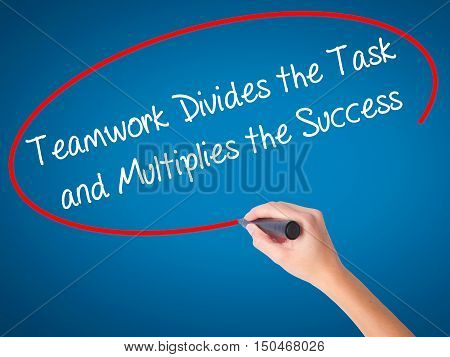 Women Hand Writing Teamwork Divides The Task And Multiplies The Success With Black Marker On Visual
