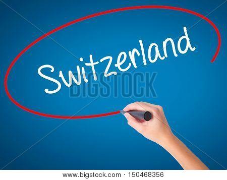 Women Hand Writing Switzerland  With Black Marker On Visual Screen